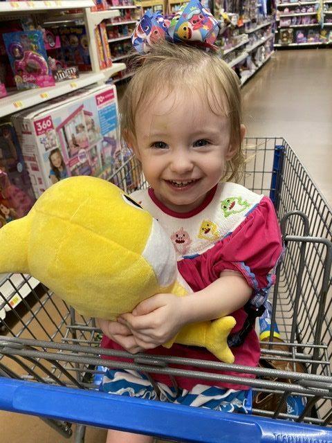 Sophia holding yellow baby shark