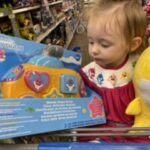 Sophia holding baby shark melody shape sorter toy
