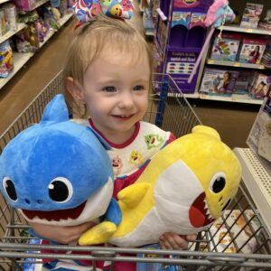 Sophia holding daddy shark and baby shark