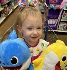 Sophia holding daddy shark and baby shark