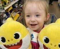 Sophia holding baby shark doll