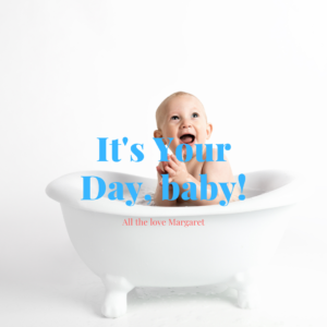 baby smiling in bath tub